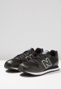 New Balance - GW500 - Sneakersy niskie - black - 4