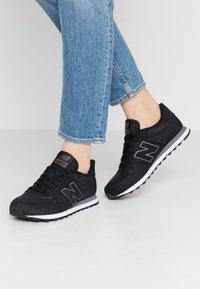 New Balance - GW500 - Trainers - black/grey - 0