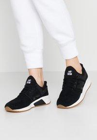 New Balance - WS247 - Sneaker low - black/white - 0