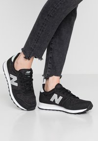 New Balance - WL311 - Sneaker low - black - 0