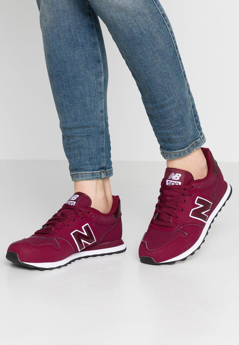 New Balance - GW500 - Sneaker low - red/white