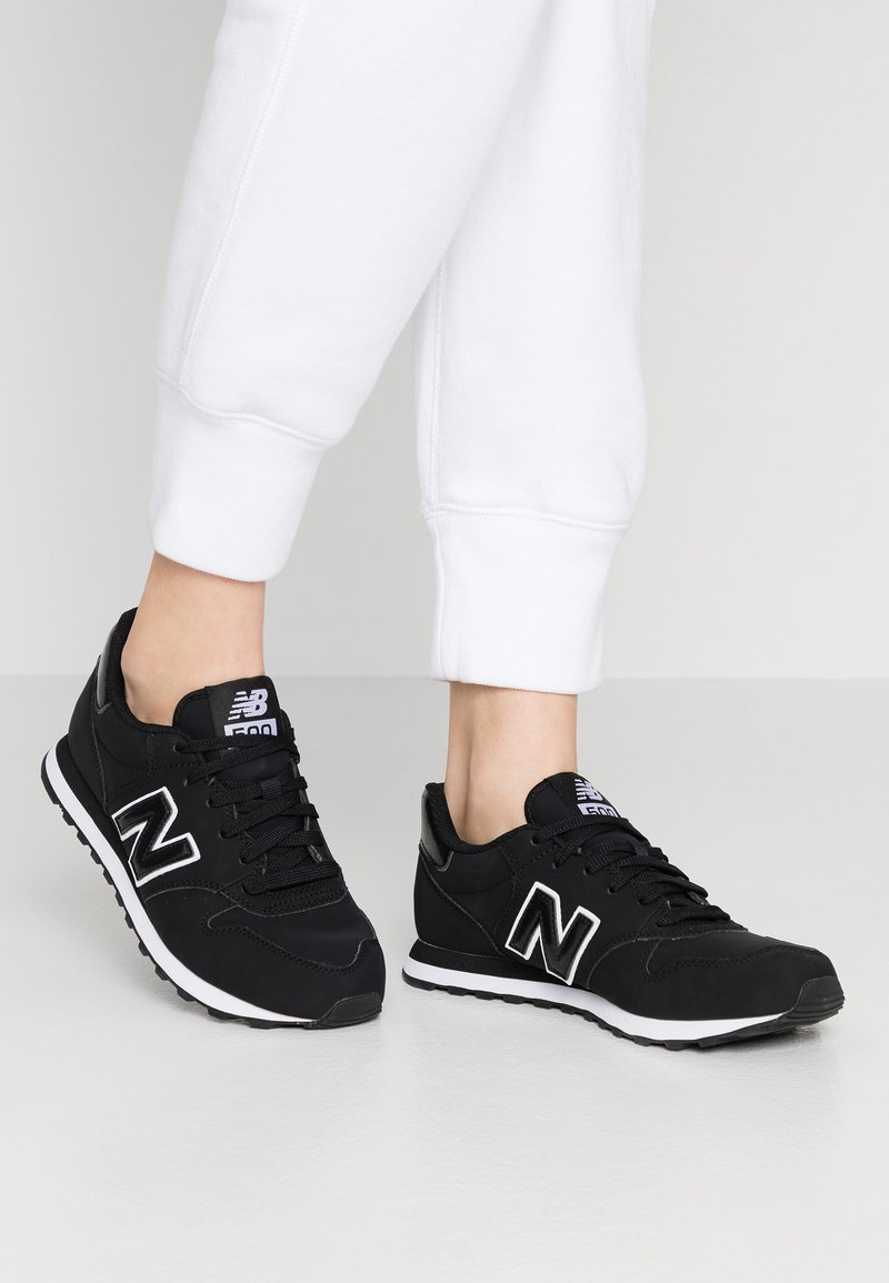 New Balance - GW500 - Trainers - black/white