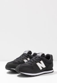 New Balance - GW500 - Sneakersy niskie - black - 4