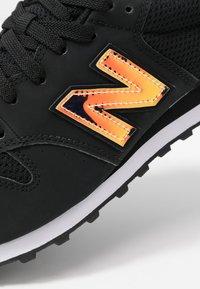 New Balance - GW500 - Matalavartiset tennarit - black - 2