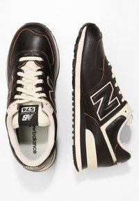 New Balance - ML574 - Sneaker low - black - 1