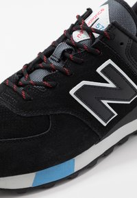 New Balance - ML574 - Sneakers - black/red - 5