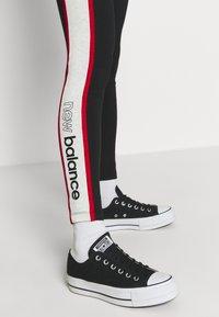 New Balance - ATHLETICS PIPING  - Leggings - Trousers - black - 3