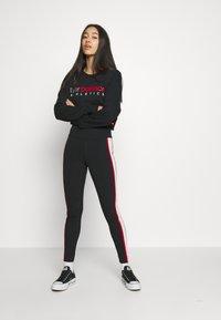New Balance - ATHLETICS PIPING  - Leggings - Trousers - black - 1