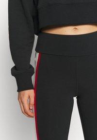 New Balance - ATHLETICS PIPING  - Leggings - Trousers - black - 5