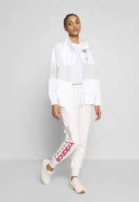 New Balance - ESSENTIALS ICON - Tracksuit bottoms - seaslhtr - 1
