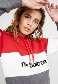 New Balance - ATHLETICS STADIUM HOODIE - Bluza z kapturem - team red - 4