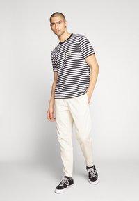 New Balance - PANT - Trousers - bone - 1