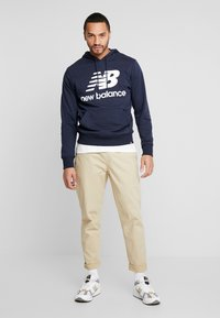 New Balance - PANT - Trousers - incense - 1