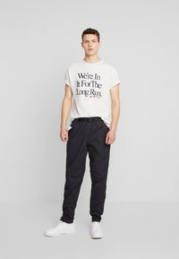 New Balance - PANT - Trousers - black - 1
