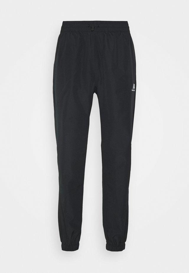 ATHLETICS WIND PANT - Tracksuit bottoms - black