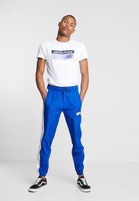 New Balance - ATHLETICS BANNER - T-shirt med print - white - 1