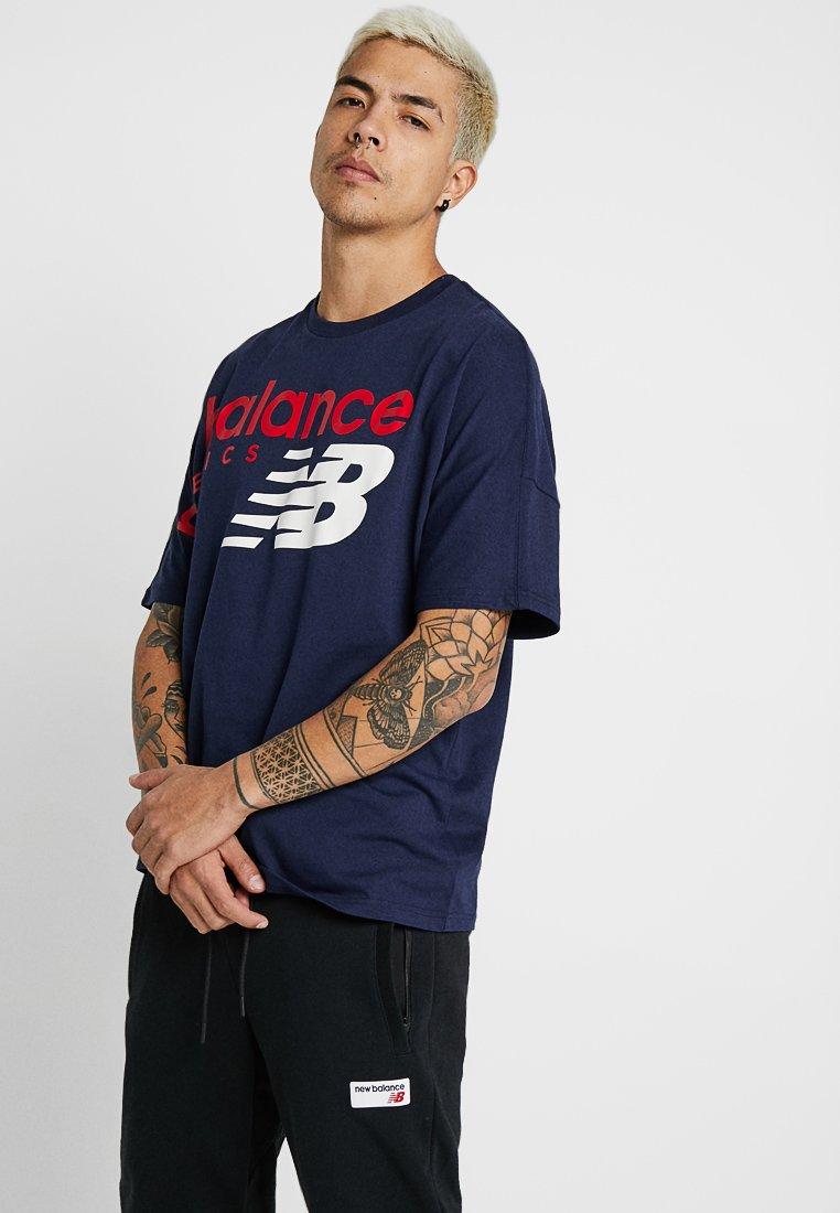 New Balance - ATHLETICS CROSSOVER - Camiseta estampada - pigment