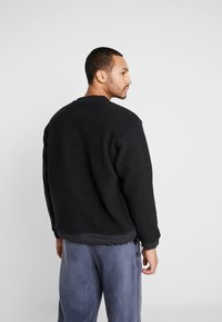 New Balance - TRAIL SHERPA CREW - Sweat polaire - black - 2