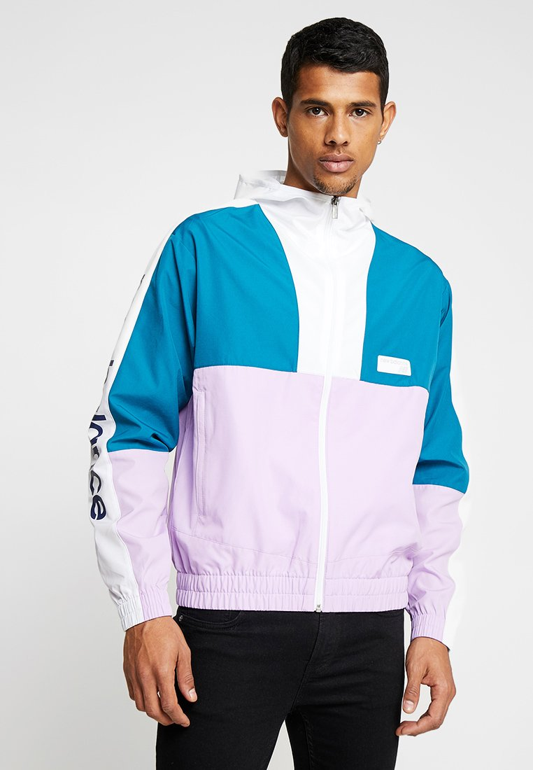 New Balance - ATHLETICS - Trainingsjacke - petrol/lilac