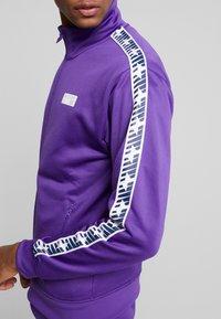 New Balance - ATHLETICS CLASSIC TRACK JACKET - Veste de survêtement - prism purple - 4