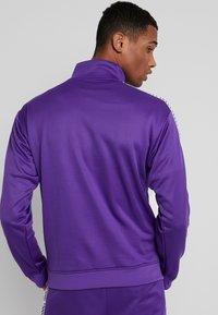 New Balance - ATHLETICS CLASSIC TRACK JACKET - Veste de survêtement - prism purple - 2