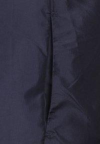 New Balance - Chaqueta de entrenamiento - dark blue - 4