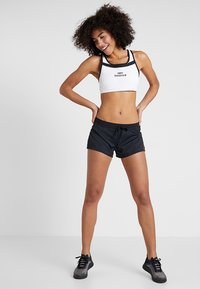 New Balance - PULSE BRA - Sport-bh - white/black - 1