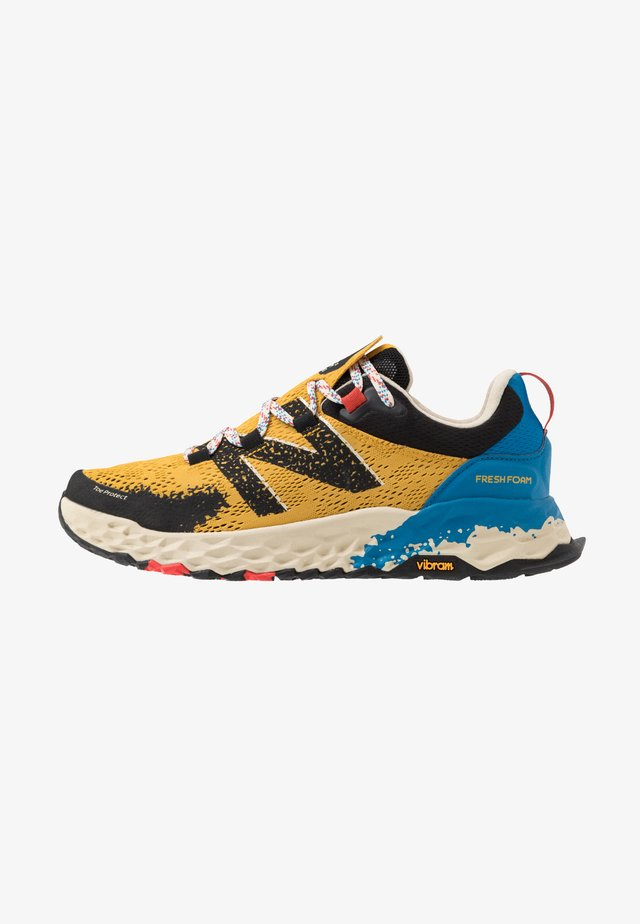 HIERRO V5 - Trail running shoes - yellow