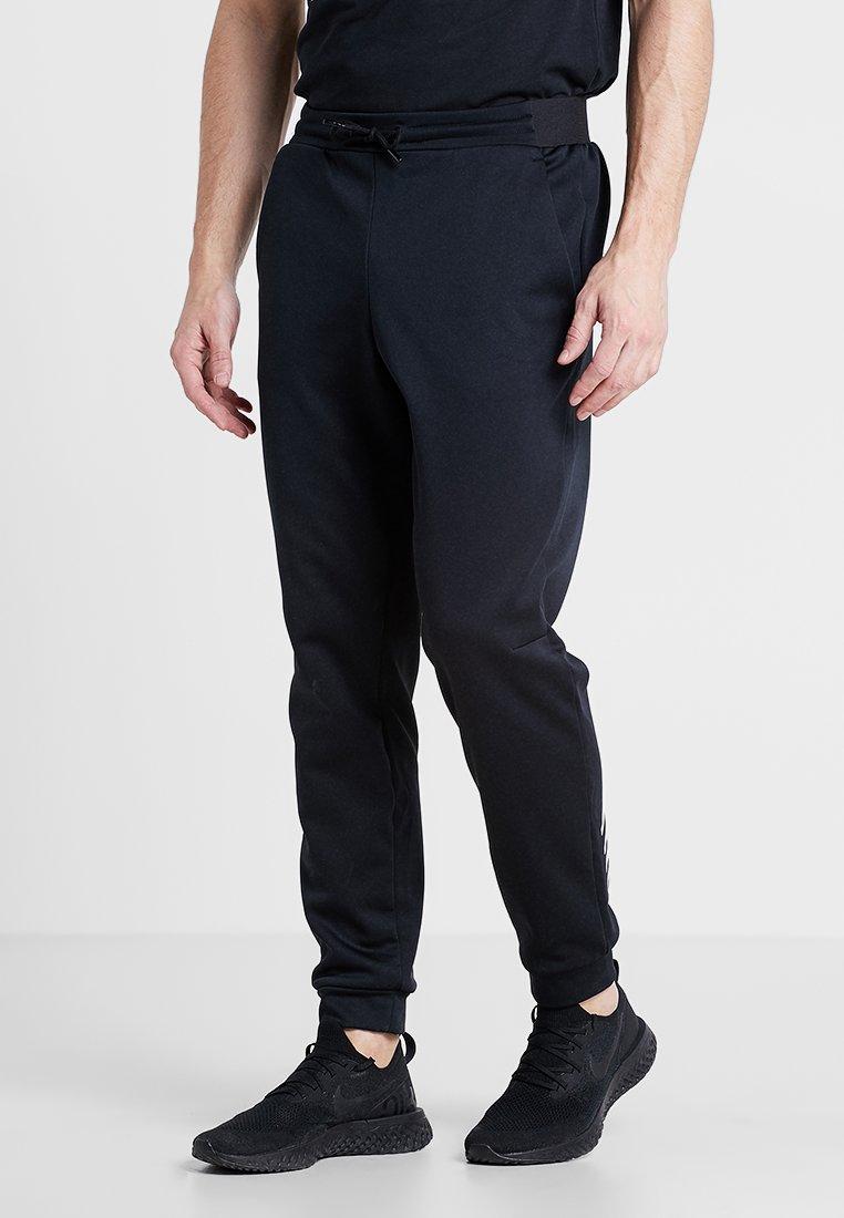 New Balance - TENACITY PANT - Jogginghose - black
