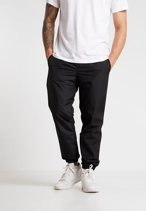 TECHNICAL TRACK PANT - Jogginghose - black