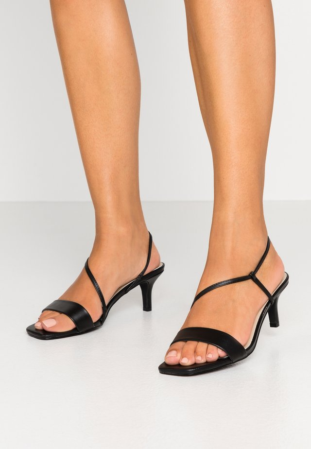 CROSS STRAPPED HEEL  - Sandały - black