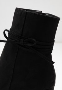 Nly by Nelly - STRAP DETAIL BOOT - High heeled ankle boots - black - 6