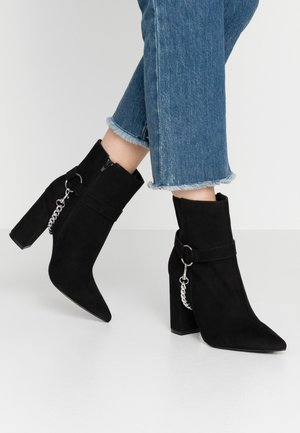 CHAIN BLOCK BOOT - High heeled ankle boots - black