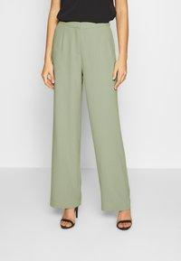 Nly by Nelly - MY FAVOURITE PANTS - Spodnie materiałowe - light green - 0
