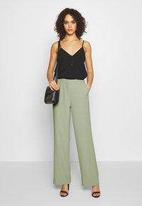 Nly by Nelly - MY FAVOURITE PANTS - Spodnie materiałowe - light green - 1