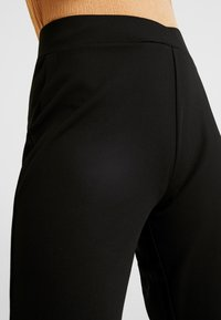 Nly by Nelly - WRAP WAIST PANTS - Spodnie treningowe - black - 4