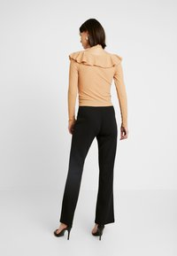 Nly by Nelly - WRAP WAIST PANTS - Spodnie treningowe - black - 2