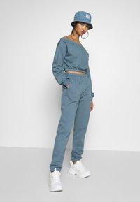 Nly by Nelly - COZY PANTS - Pantaloni sportivi - blue - 1
