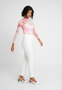 Nly by Nelly - SPARKLING EDGE - Trousers - white - 1