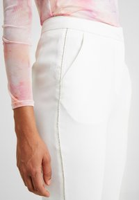 Nly by Nelly - SPARKLING EDGE - Trousers - white - 3