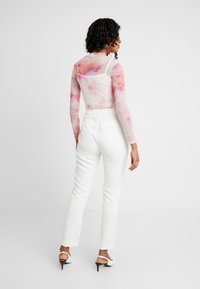 Nly by Nelly - SPARKLING EDGE - Trousers - white - 2