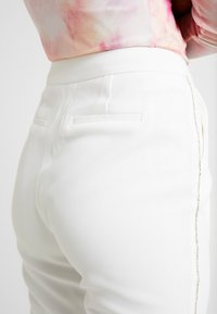Nly by Nelly - SPARKLING EDGE - Trousers - white - 5