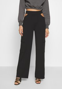 Nly by Nelly - CUT OUT PANTS - Bukse - black - 0
