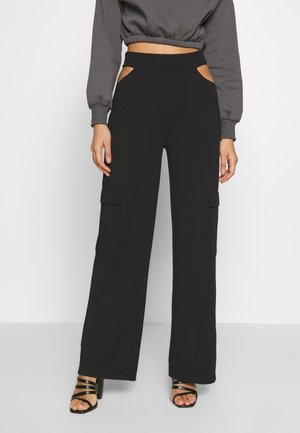 CUT OUT PANTS - Broek - black