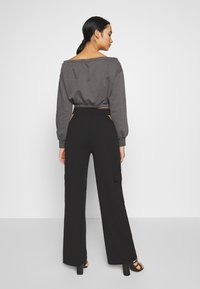 Nly by Nelly - CUT OUT PANTS - Bukse - black - 2