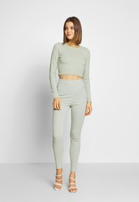 Nly by Nelly - HIGH WAIST SET - Leggings - Trousers - pistage - 0