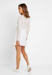 Nly by Nelly - WRAPPED FRILL SKIRT - Jupe portefeuille - white - 2