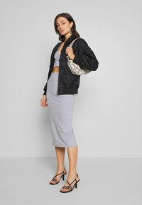 Nly by Nelly - CUT OUT SLIT SET - Maxi skirt - grey mélange - 1