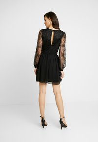 Nly by Nelly - RITZY GLITTER SKATER DRESS - Cocktailklänning - black - 3