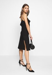 Nly by Nelly - CHAIN STRAP DRESS - Koktejlové šaty / šaty na párty - black